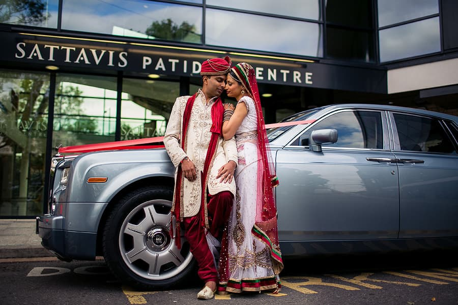 sattavis patidar centre, exterior, asian wedding photographer, bride and groom posing